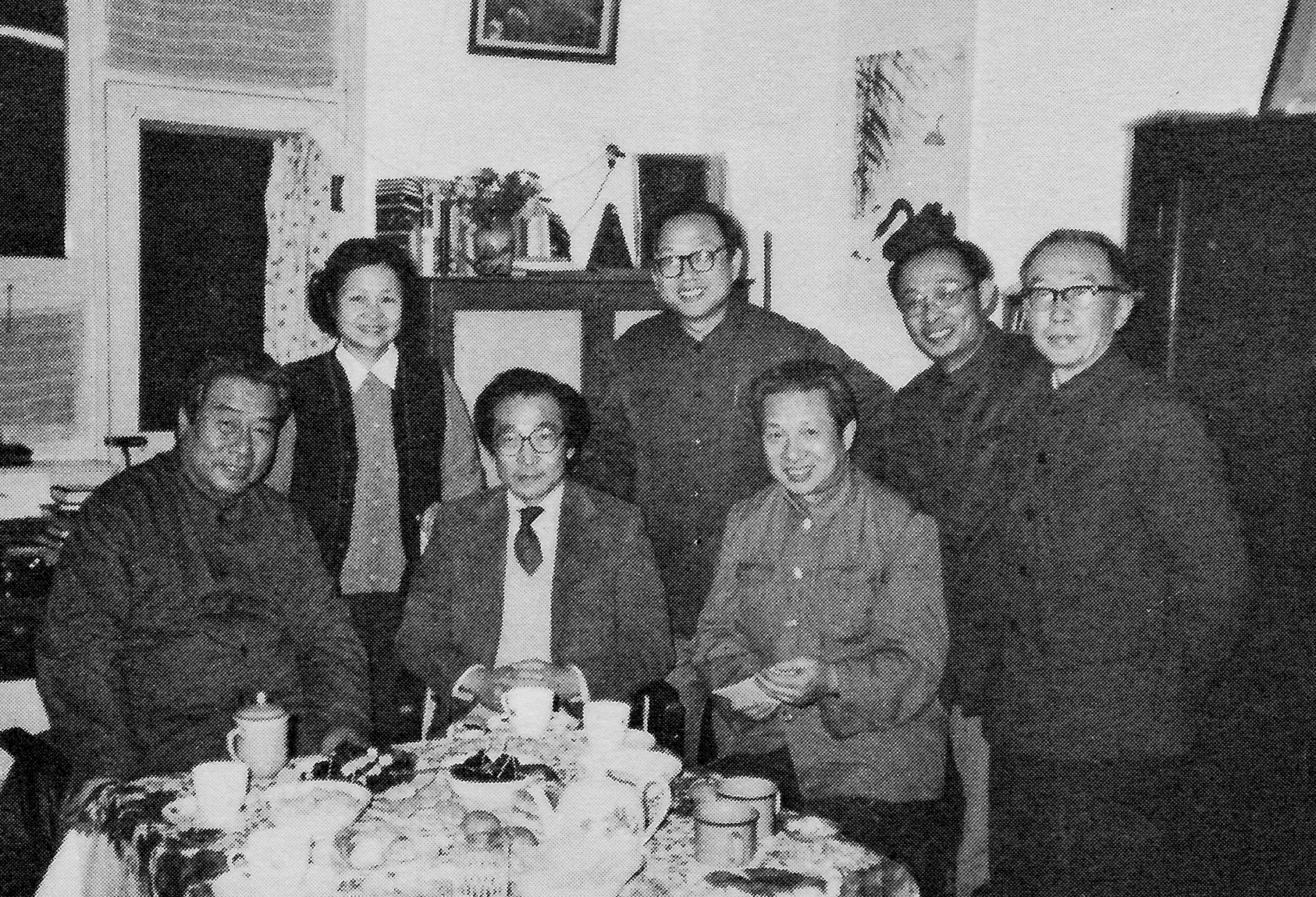 Members of the Central Philharmonic Orchestra gather here at the home of conductor Li Delun. Chou Wen-chung is seated between conductors Li Delun (left) and Han Zhongjie (right). Standing from left to right are Wu Meihe, Luo Qing, Zhu Xinren, and Meng Zhaolin.