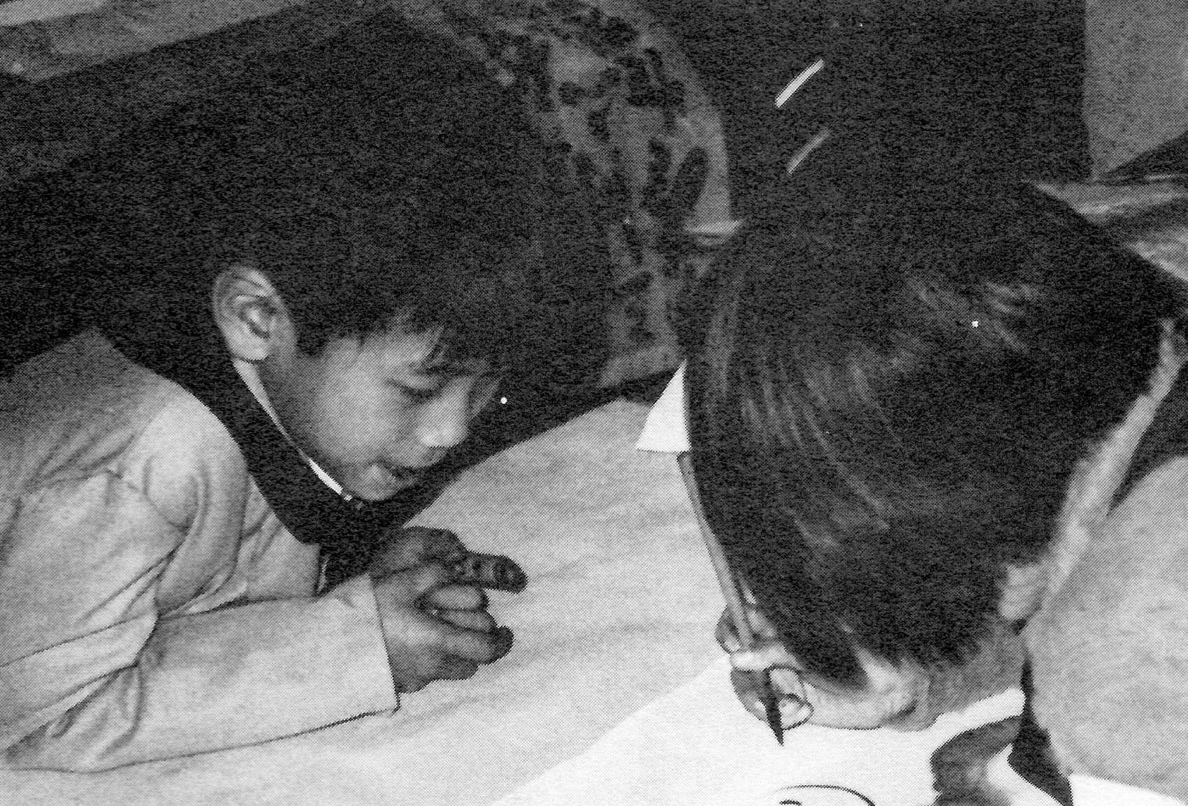 Children doing brush-stroke painting, Liuzhou, China