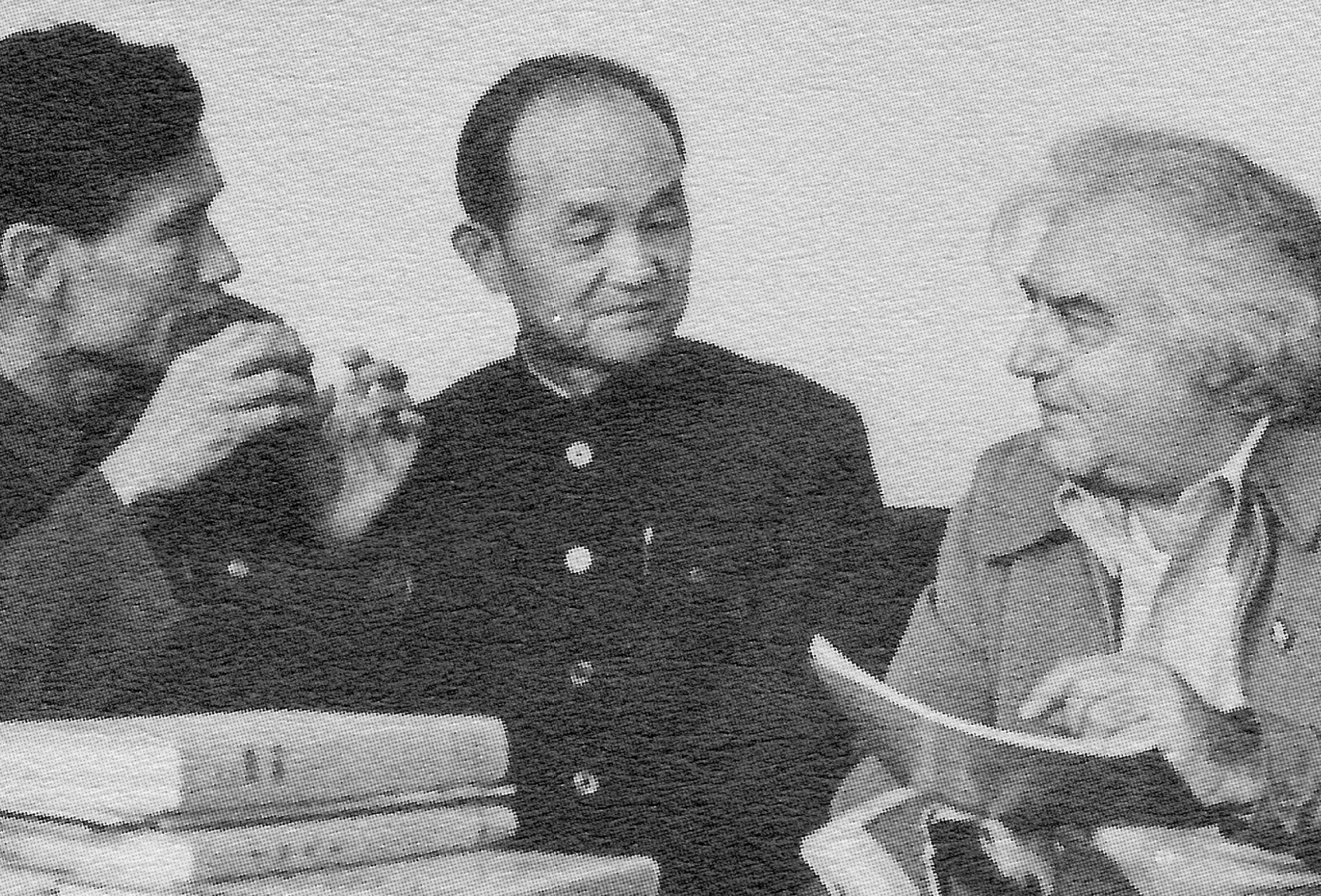 Cornell Capa, director of the International Center of Photography, with Xu Xiaobing (center), chairman of the Chinese Photographers Association. An interpreter is to his right.