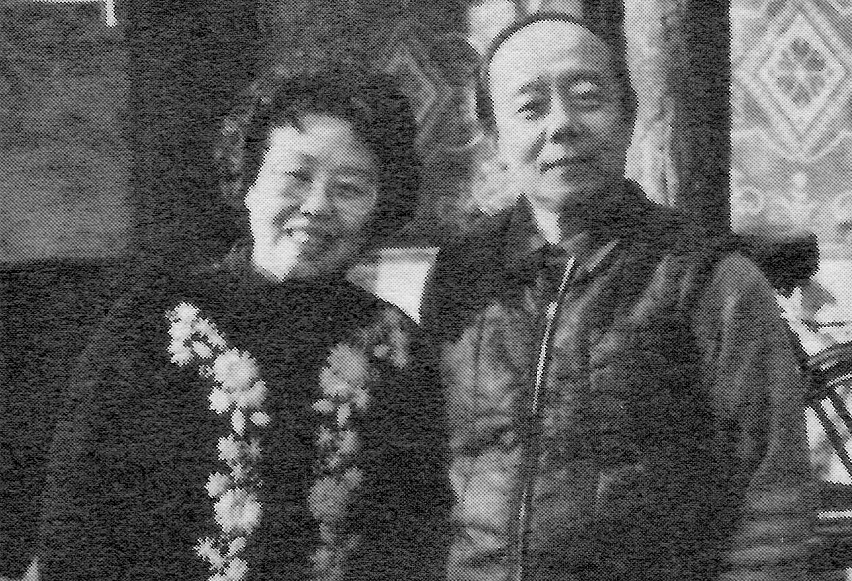 Costume designer Li Keyu and husband composer Mao Yuan in front of their home in Beijing