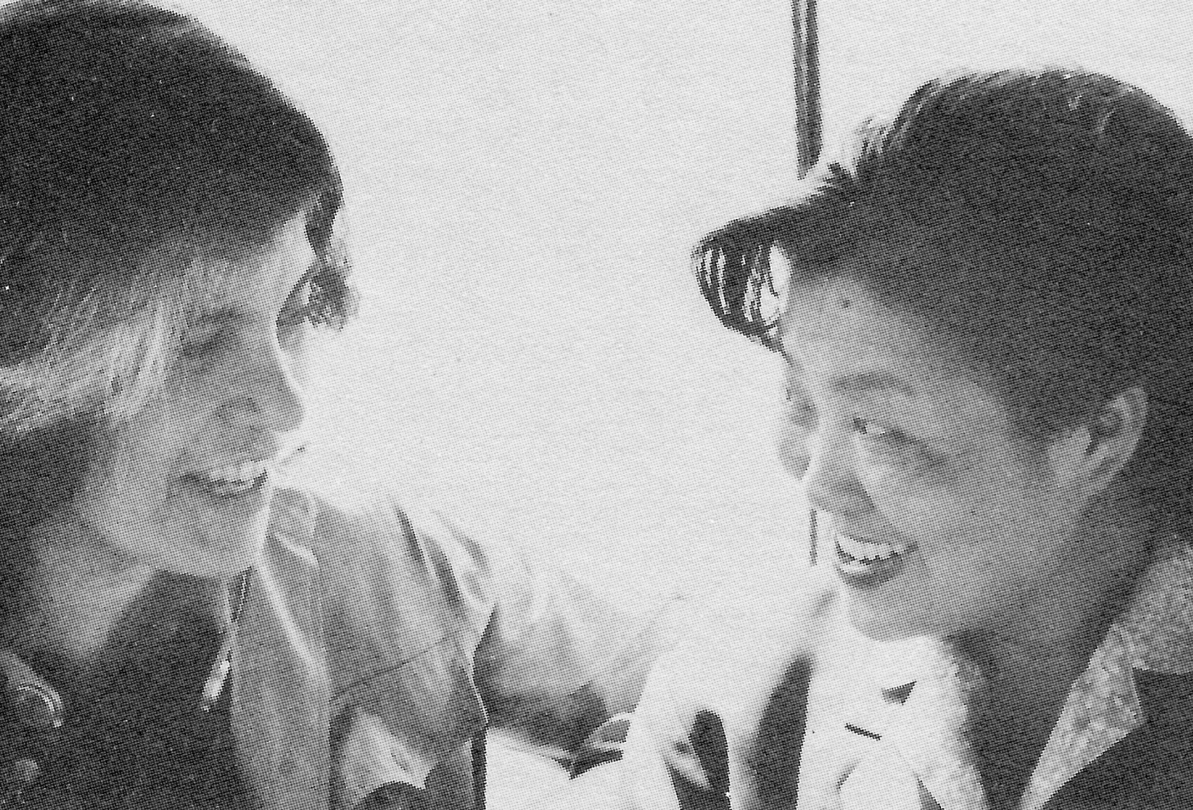 Writer Susan Sontag with He Huaren, staff member of the China Federation, during a boat tour of the West Lake, Hangzhou