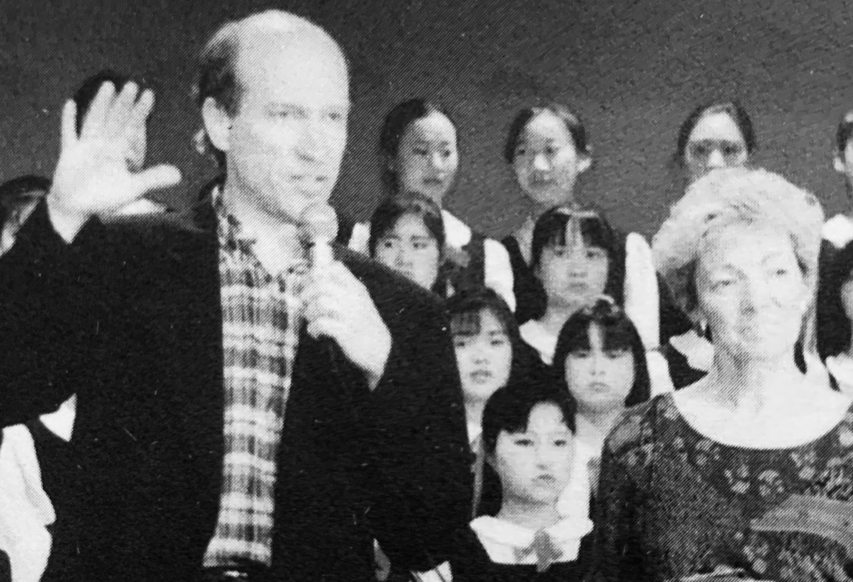 Minnesota music teachers Tom Wells (center left) and Dawn Allan (center right) say farewell to students at the Kunming Normal School for Kindergarten Teachers. Standing with them are the school's principal, Lu Chongbi (far right), and their interpreter, Su Li (front left).