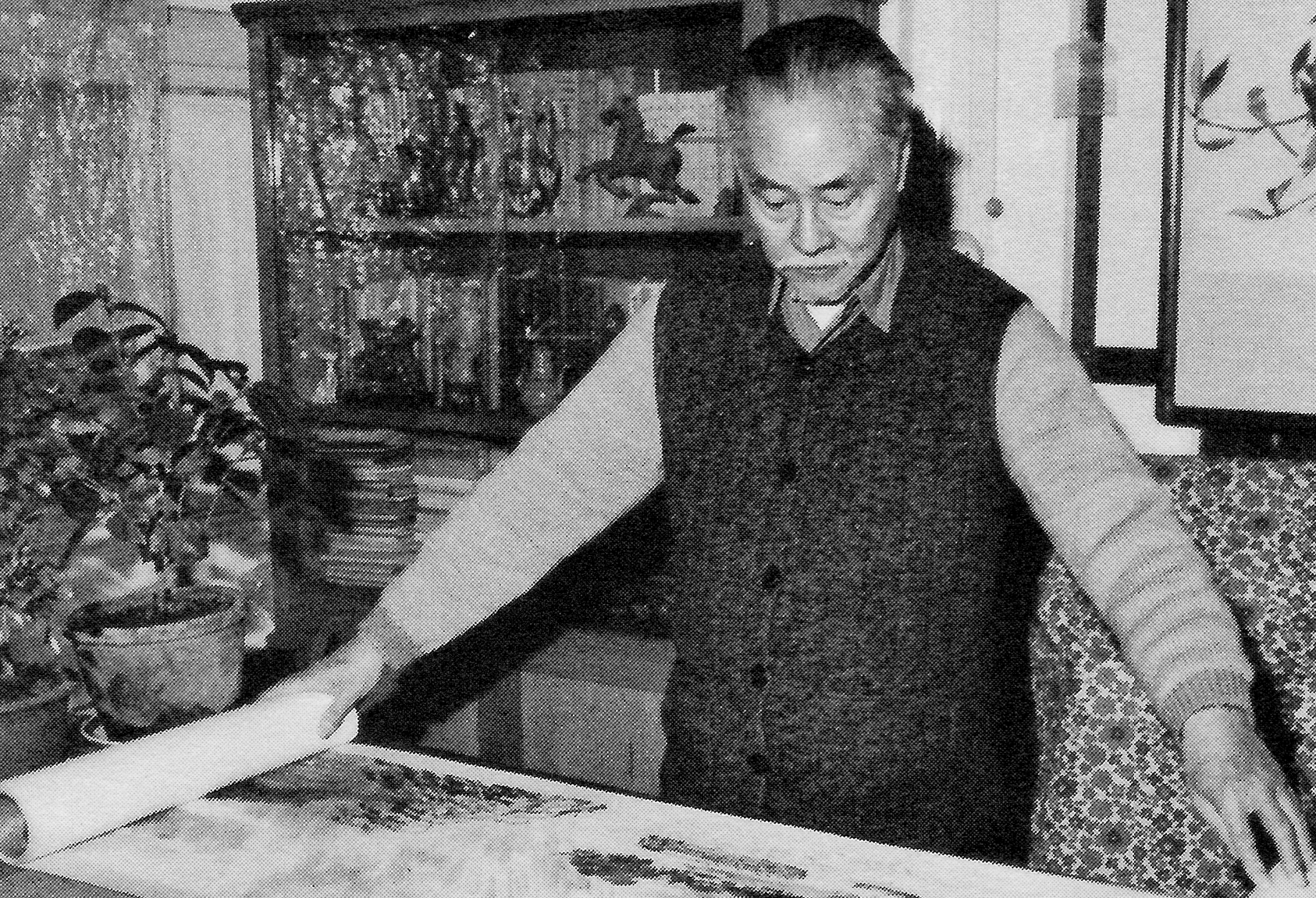 Ye Qianyu, well known painter and cartoonist, displays his work at his home in Beijing. During the December trip, many individual artists were eager to discuss their possible involvement in the Center's programs.