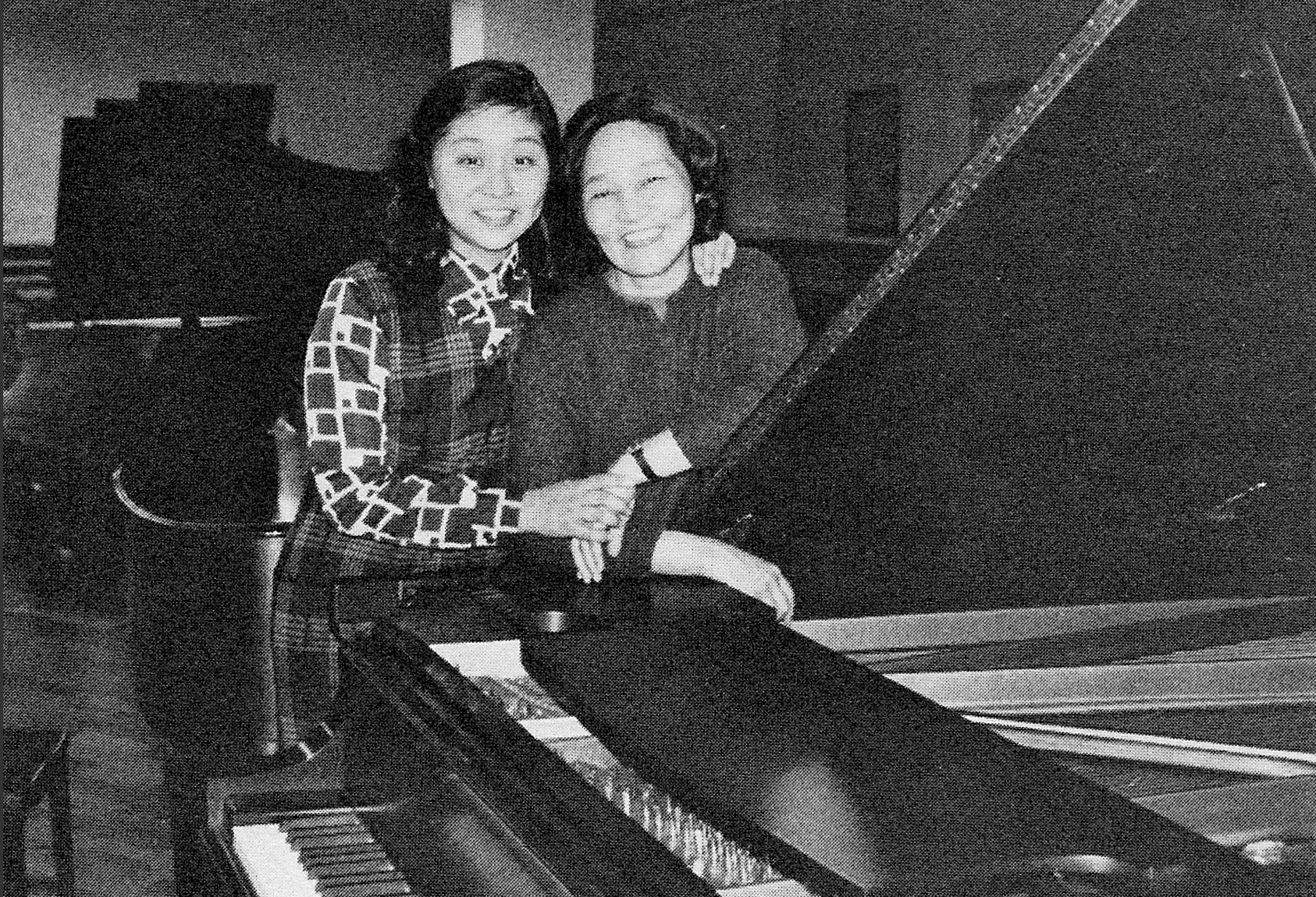 In January of this year, the Center invited Madame Zhou Guangren, pianist and teacher at Beijing's Central Institute of Music, to New York for a week of musical activities. She visited the city's music institutions and attended opera and concert performances. Here she is shown with her daughter at Steinway Hall after trying out concert grands. Madame Zhou's visit to the U.S. was sponsored by the University of Missouri, Kansas City.
