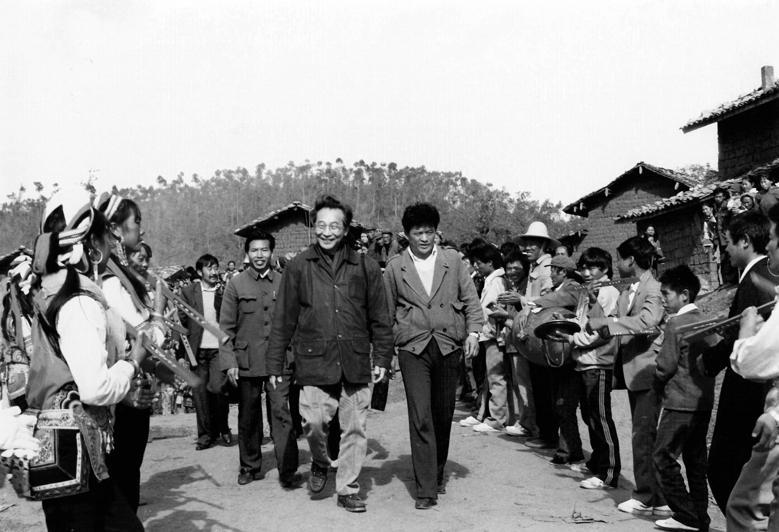 Chou Wen-chung greets Wujiepu Village residents in Luxi County during his December 1990 research trip to Yunnan Province